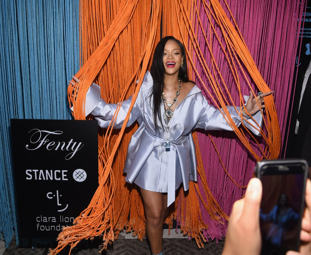 """Rihanna stepped out for the Fenty x Stance event in NYC on Wednesday sporting a radiant glow that had the entire room illuminating. The 30-year-old """"Diamonds"""" singer slipped into a silky outfit with strap sandals to promote her Clara Lionel Foundation in collaboration with the noted sock brand. The self-proclaimed """"bad gal"""" has launched several sock collections with Stance since 2015, with her most recent collection debuting last February. Inside, Riri greeted fans and posed for pictures with her mom Monica Braithwaite, and Clara Lionel Foundation executive director Justine Lucas and director Fiona Korwin-Pawlowski Ryan.  The Ocean's 8 star also took snaps with the brand's CMO Candy Harris and director Lindy Rich. Whether it was the act of giving back that had her glowing, or it was her Fenty body lava that had Rihanna's skin glistening, these photos will definitely leave a sparkle in your eye. Keep reading to see more from Rih's fun (and philanthropic) night out.      Related:                                                                                                           Warning: These Sexy GIFs of Rihanna Will Give You Wild, Wild Thoughts"""