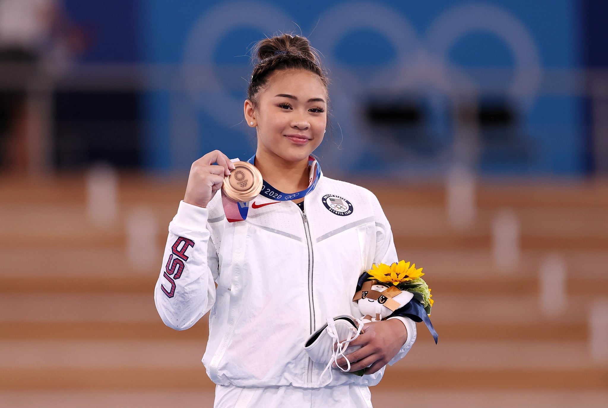 TOKYO, JAPAN - AUGUST 01: Bronze Medalist Sunisa Lee of Team United States poses with her medal on the podium during the Women's Uneven Bars Final medal ceremony on day nine of the Tokyo 2020 Olympic Games at Ariake Gymnastics Centre on August 01, 2021 in Tokyo, Japan. (Photo by Laurence Griffiths/Getty Images)