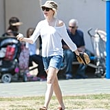 A longer-length pair of shorts like Naomi Watts's look great worn with a loose top and simple accessories for a warm day when you don't want to worry too much about your outfit.