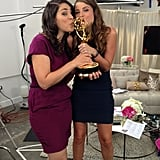 BuzzSugar's Becky Kirsch, in 3.1 Phillip Lim, and PopSugar's Molly Goodson, in Rag & Bone, kissed an Emmy for good luck before going live.
