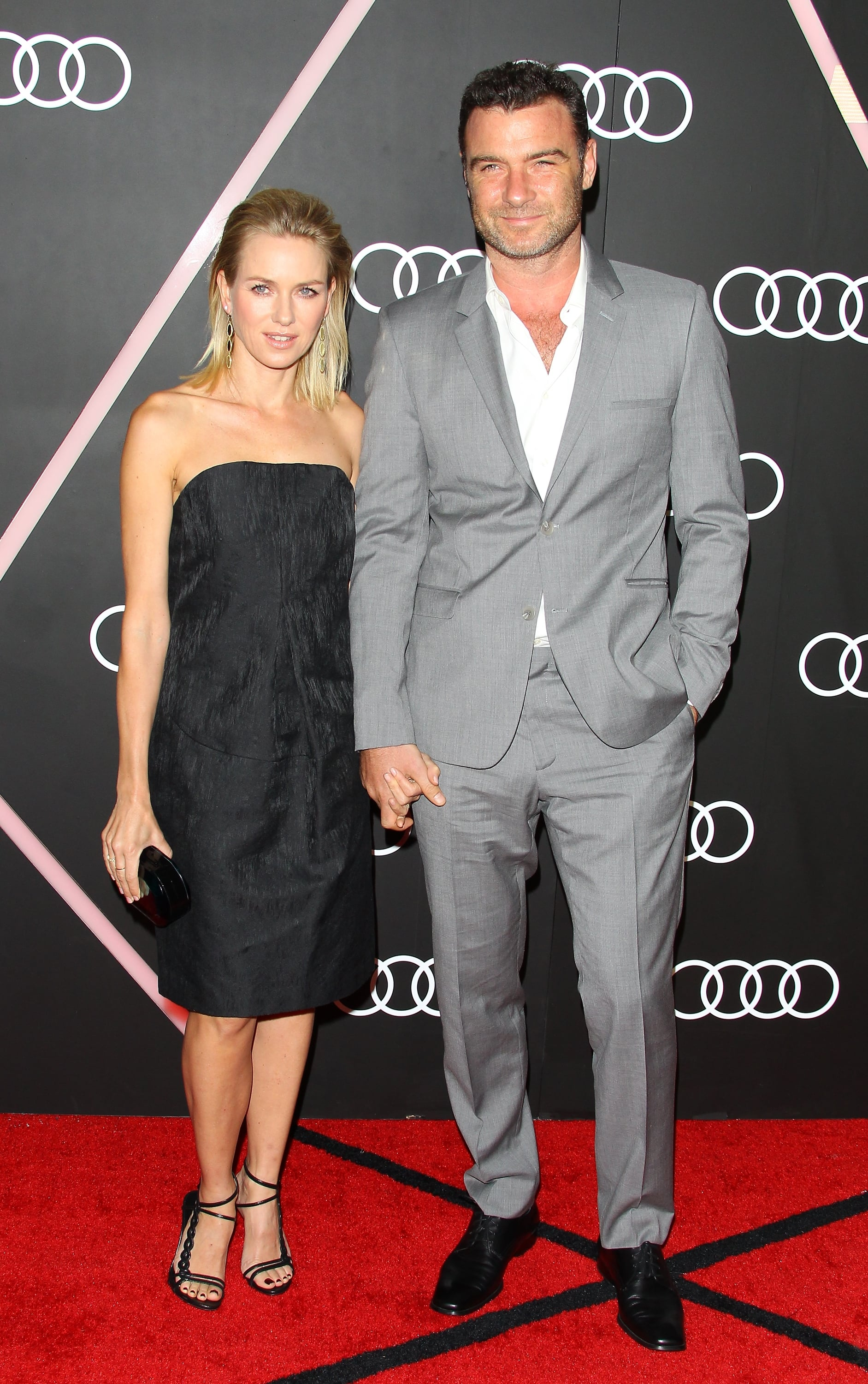 Naomi and Liev held hands on the carpet.