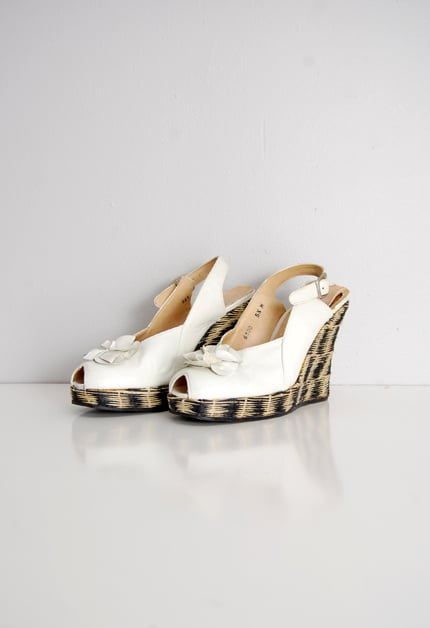 These vintage wedges look straight from the Proenza Schouler Spring '12 runway.  Adore Vintage 1940s Platform Wedges ($98)