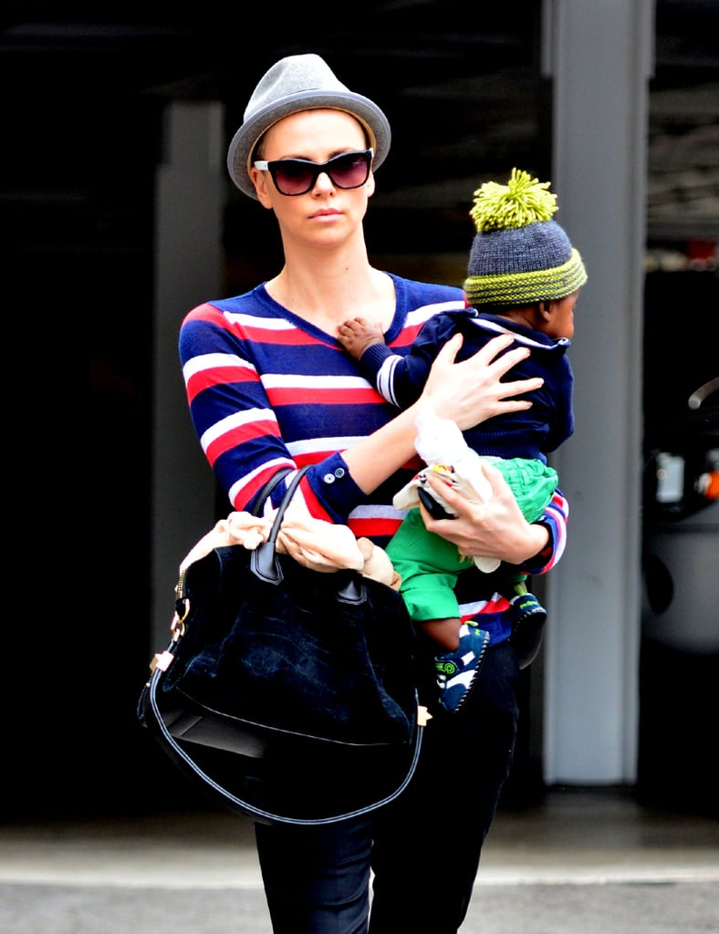 Charlize Theron carried her son, Jackson Theron, while out running errands in LA yesterday. The duo spent time together after Charlize took a yoga class solo on Sunday. Charlize sported a hat both afternoons, and there's a reason why — Charlize shaved her head! She needed to lose her locks for her new role in a Mad Max remake. However, Charlize's usual blonde hair is on display in the two movies she has released in June: Prometheus and Snow White and the Huntsman. Charlize's SWATH co-stars Kristen Stewart and Chris Hemsworth will be in Australia next week to promote the film.