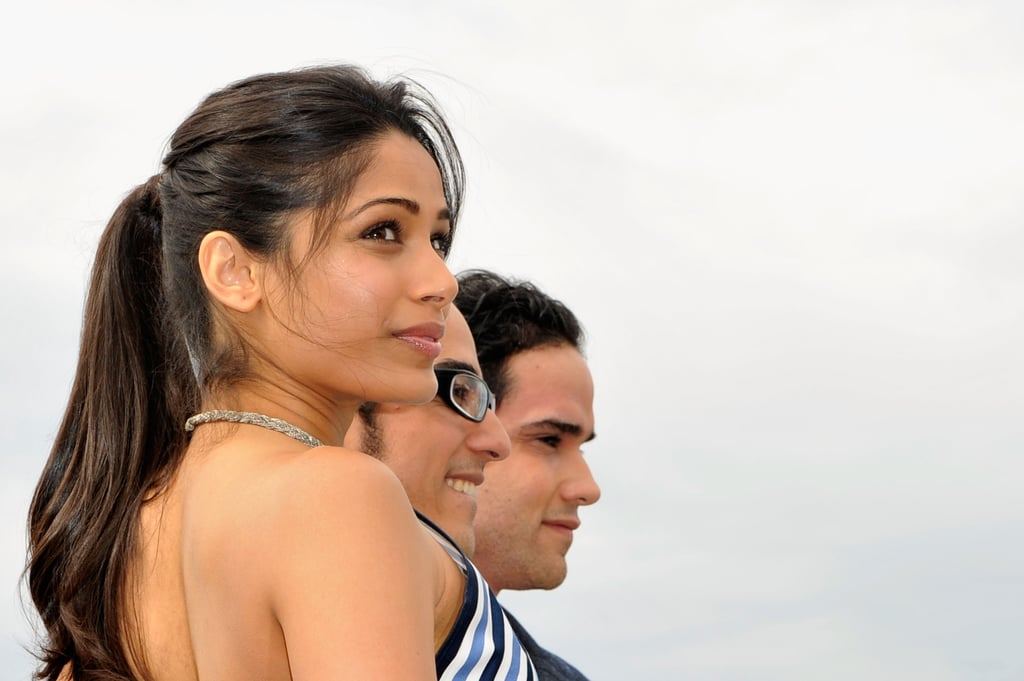 Freida Pinto smiled with costars at the Desert Dancer photocall at the Cannes FIlm Festival.