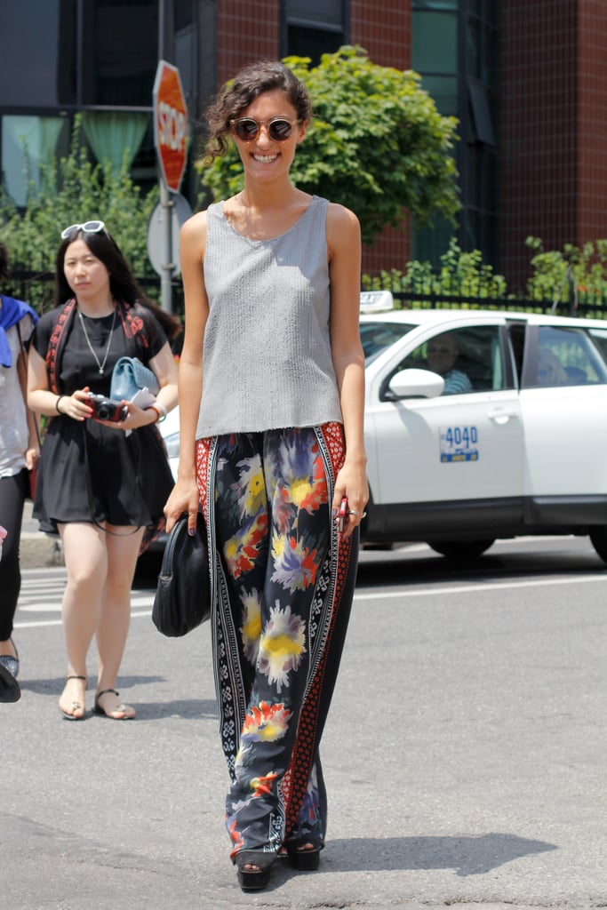 Opt for a more unconventional approach to breezy dressing by wearing silky pants and a tank.