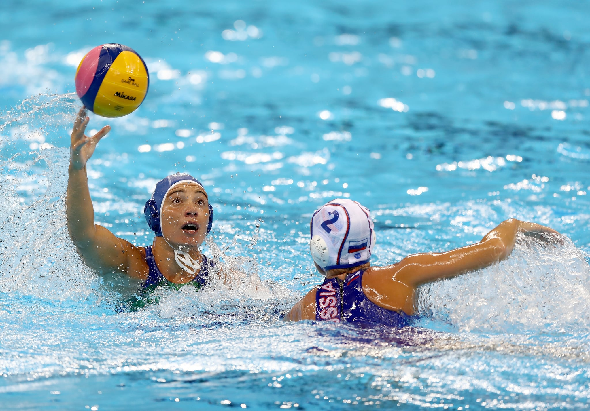 RIO DE JANEIRO, BRAZIL - AUGUST 17:  Roberta Bianconi #8 of Italy passes the ball as Ekaterina Lisunova #2 of Russia defends during the Women's Water Polo at Olympic Aquatics Stadium on August 17, 2016 in Rio de Janeiro, Brazil.  (Photo by Elsa/Getty Images)