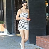 She Wore the Dress With White Sneakers and Matrix-Inspired Sunglasses