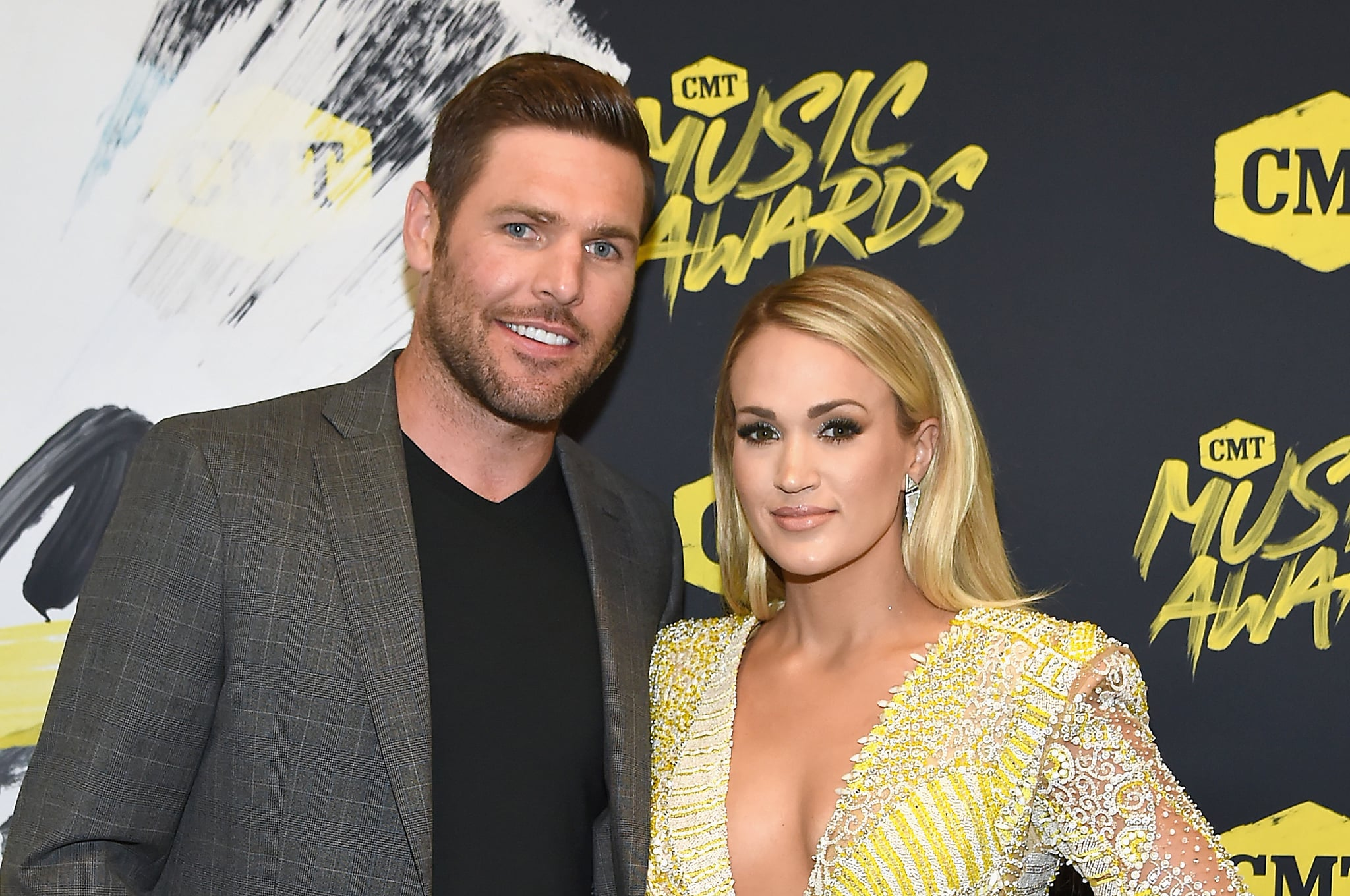 NASHVILLE, TN - JUNE 06:  Mike Fisher (L) and Carrie Underwood attend the 2018 CMT Music Awards at Bridgestone Arena on June 6, 2018 in Nashville, Tennessee.  (Photo by Rick Diamond/Getty Images for CMT)