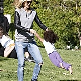 While playing with her kids at a park in LA, Heidi Klum sported black leather high-top sneakers with torn jeans and a leather-sleeved hoodie sweatshirt.