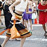 Model Hanne Gaby Odiele made running around NYFW look adorable in a Proenza Schouler midi skirt. Source: Greg Kessler