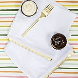 If stamping designs on your napkins isn't your style, you can go for a more year-round look, adding DIY scalloped edges to plain white napkins for a holiday look that shines.