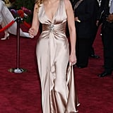 Julia wore a champagne Giorgio Armani gown with a plunging neckline and gathered center at the 2004 Oscars.