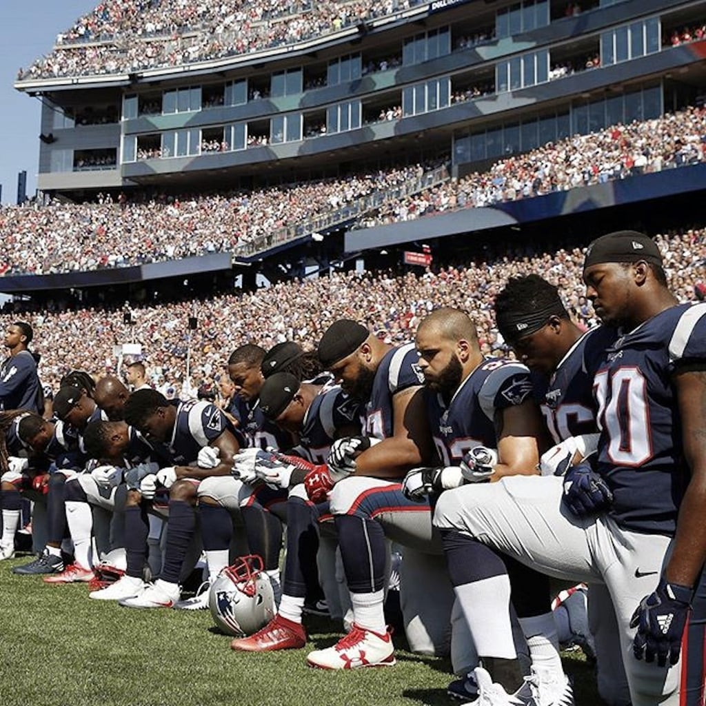 You'll Love the Reason So Many American Football Players Are Kneeling During the National Anthem