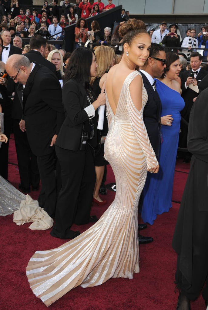 Jennifer Lopez wowed in Zuhair Murad at today's Oscars, held inside the Hollywood and Highland Center in LA. She posed solo on the red carpet on her way into the show, where she's a presenter. J Lo just returned to the West Coast after a trip to Brazil with boyfriend Casper Smart for Carnival. He didn't join her on the carpet, but there will be plenty of opportunities for him to get in on the fun with all the after parties around town tonight. Weigh in on Jennifer's look, as well as the rest of the Oscars red carpet style, by voting on Fab and Bella's polls.