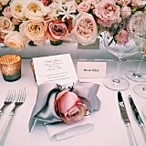 Roses of all colours made a table arrangement to die for.