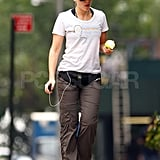 Scarlett Johansson in NYC with an apple.