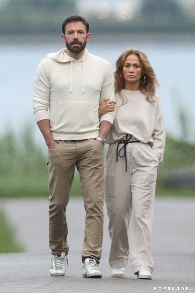 """Jennifer Lopez and Ben Affleck are keeping close on their Hamptons getaway. The couple were spotted snuggling up over the July 4th weekend as they took an evening stroll, and as if that wasn't sweet enough, they were wearing complementary athleisure. Jen and Ben already have a history of iconic fashion moments together, and it looks like these will only continue as their romance rekindles. This vacation comes shortly after Jen and Ben were spotted on a fun family outing with their kids at Universal Studios. The pair have kept the cute appearances coming since reuniting back in May, and it looks like things are still going strong. The sparks are still flying! Get a look at """"Bennifer's"""" Hamptons holiday in the photos ahead.       Related:                                                                                                           Wait, What? See the Celebrity Couples of 2021 Who Made Us Question Everything"""