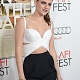 Kristen's look juxtaposed a revealing, high-impact top with more classic, high-waist trousers.