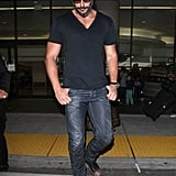 Joe Manganiello crossed the street as he left LAX.