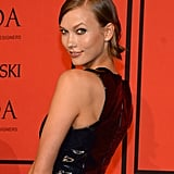 Karlie Kloss slicked her famous bob off to the side for a sophisticated take on the lob trend.