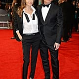 Angelina Jolie and Brad Pitt matched in suits at the BAFTA Awards, where he took home best film for his work coproducing 12 Years a Slave.