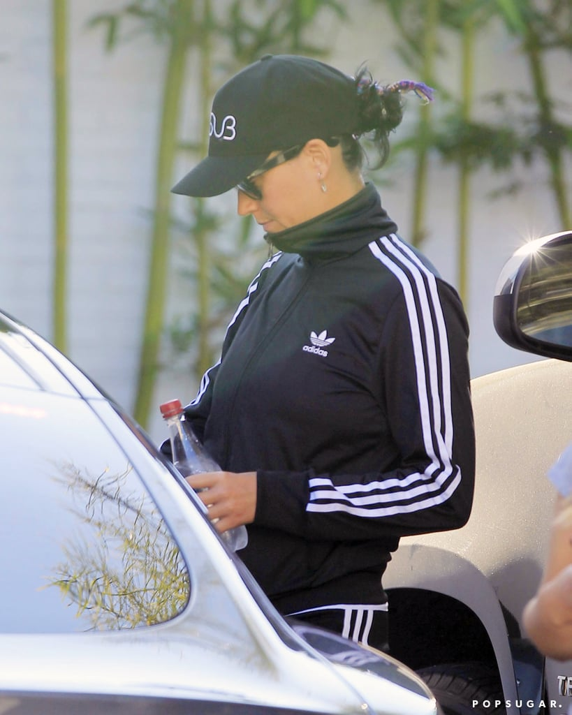 "Following her romantic Italian vacation with boyfriend Orlando Bloom, Katy Perry was seen out and about in LA on Saturday afternoon. The ""Rise"" singer kept a low profile in a baseball cap and sunglasses complete with a black and white Adidas tracksuit. Katy and Orlando's getaway did have its share of scandals though, as pictures surfaced of a naked Orlando paddleboarding with Katy. Not long after, Katy grabbed headlines when she posted a photo of herself flashing her underwear during a bike ride in France, writing, ""I know it's a little cheeky, butt... Cycling in The ile de re, France."" See more of Katy in various states of undress."