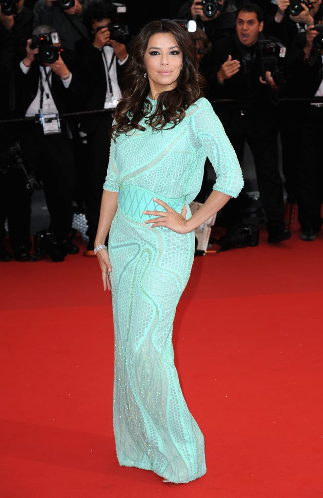 At the 2013 Cannes Film Festival, Eva struck a pose in a soft turquoise Atelier Versace concoction complete with matching corset belt.