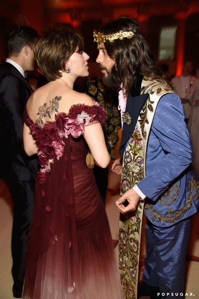 "Jared Leto arrived in style for the Met Gala in NYC on Monday night, channelling a healthy mix of Jesus, Mary, and Joseph with his over-the-top Gucci ensemble. After walking the red carpet, Jared headed inside for the annual event and met up with one of his famous ex-girlfriends, Scarlett Johansson. The former couple were spotted smiling, chatting, and even posing for a few photos, proving that they're on good terms. Scarlett's date, boyfriend Colin Jost, was nowhere in sight. Jared and Scarlett began dating in 2004. Though they ended things a year later, they reunited in 2012 at the Democratic National Convention and were seen holding hands and snapping selfies together. Four years later, in an interview with Cosmopolitan, Scarlett revealed details about a past romance — and though she didn't identify the ex, it could very well have been Jared. ""Long, long ago, I had someone in my life who was forever unavailable . . . but, like, so attractively unavailable,"" she told the magazine.  In addition to linking up with his ex, Jared also stirred new dating rumours thanks to one of his Met Gala dates. His entrance with singer Lana Del Rey got tongues wagging that they could be an item — but since they both arrived with Gucci designer Alessandro Michele (who designed their looks), it may have just been a friendly night out. Keep reading to see Scarlett and Jared's Met Gala reunion."