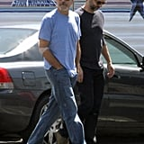 George Clooney wore a blue t-shirt on set at an airport in Los Angeles.