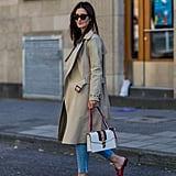 With a trench and preppy slides