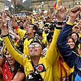 In Bogotá, Colombia, fans celebrated, jumping up and down.