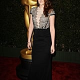 For an award ceremony in December 2012, Kristen chose a lace- and sequin-embellished Talbot Runhof gown and finished it off with classic black pumps and a dainty Cartier bracelet.