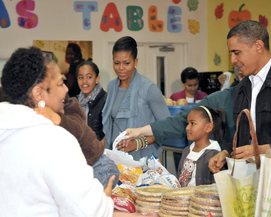 The Obama family distributes food at Martha's Table and pardon a turkey for Thanksgiving