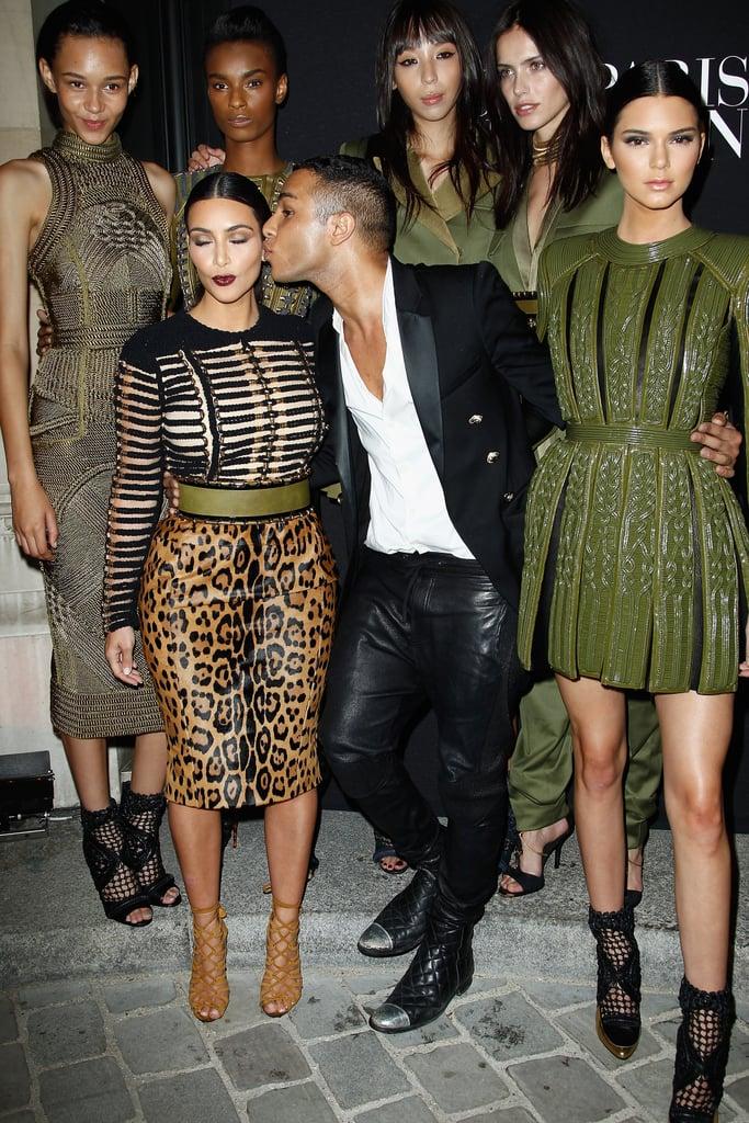 043f202e3ea Kim Kardashian got a kiss from Balmain designer Olivier Rousteing as she  and sister Kendall Jenner