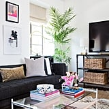 """Shay's favorite part of the remodel is this sitting area. """"It just feels so welcoming, which is the complete opposite of what this space was before. (Think: storage unit.) It's also the first thing your eye hits when you walk in the door. You just want to cozy up and stay!"""""""