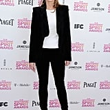 "Helen Hunt chose a black pantsuit look, only opting for ""color"" via a white top."