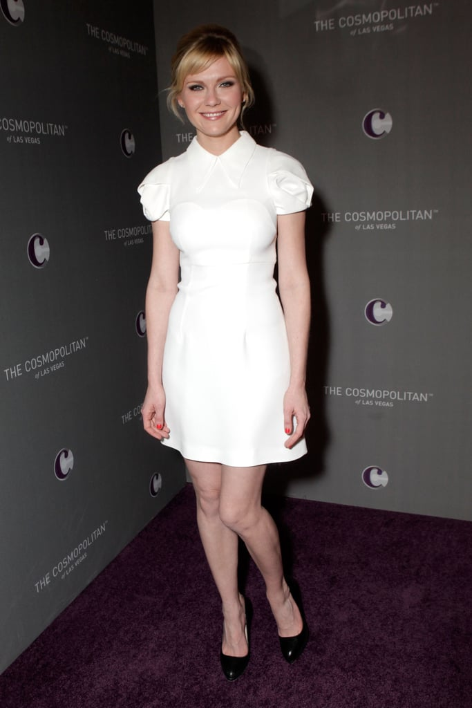 Kirsten Dunst kept it short and sweet in a Winter-white Miu Miu dress.
