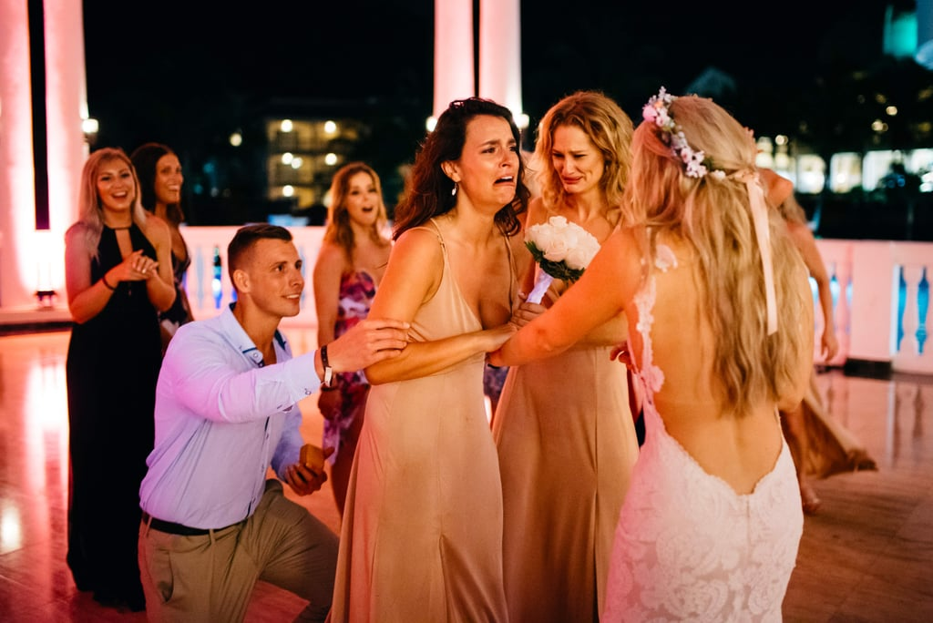 Another Guy Proposed to His Girlfriend at a Wedding —This Time, the Bride Helped Plan It