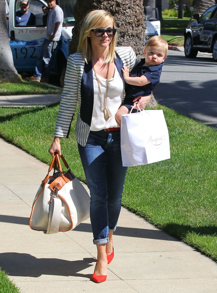 Just like Reese Witherspoon did while on mommy duty in LA recently, pair a striped blazer with your favorite denim, then amp things up with a pair of red pumps. Then jazz things up even more with statement sunglasses and a gold necklace.