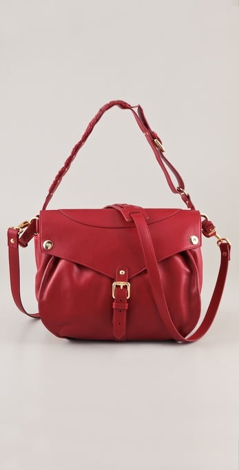 With buckled-strap details, braided banding, gold hardware, and a red-hot hue, this satchel would be a great date-night add-on.  Thakoon Rampling Satchel ($1,890)