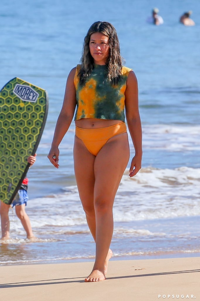 Gina Rodriguez is making the most out of her time in Hawaii. The 34-year-old actress was honored at the Maui Film Festival with the navigator award last Thursday, and she celebrated the best way she knew how — by hitting the beach, of course. Ahead of being recognized for her achievements in the entertainment industry through her roles in TV shows and movies like Jane the Virgin and Miss Bala, Gina stopped by the beach for some fun in the sun. The actress appeared to be in a good mood as she splashed around and went boogie boarding. On Monday, Gina was back on the beach, only this time one of her friends joined her. She's also been sharing photos from her trip on Instagram, but fair warning: they'll give you major FOMO. Yep, Gina clearly knows how to work hard and play hard.       Related:                                                                                                                                9 Things You Didn't Know About Gina Rodriguez