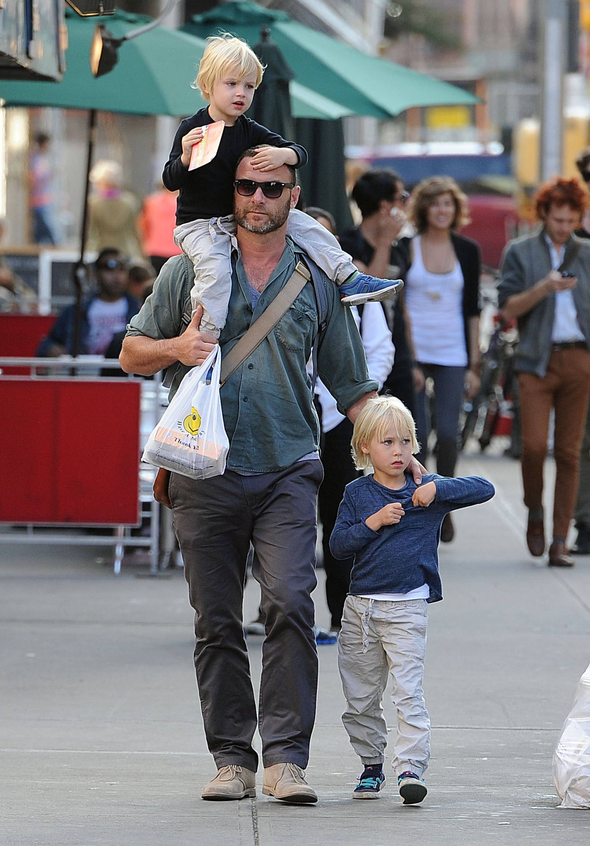 Liev Schreiber gave son Kai a lift on his shoulders while Sasha stayed close by during a stroll around the Big Apple.