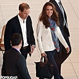 Kate Middleton wore a colorful scarf with a white sweater to travel through Brisbane, Australia with Prince William on their way home.