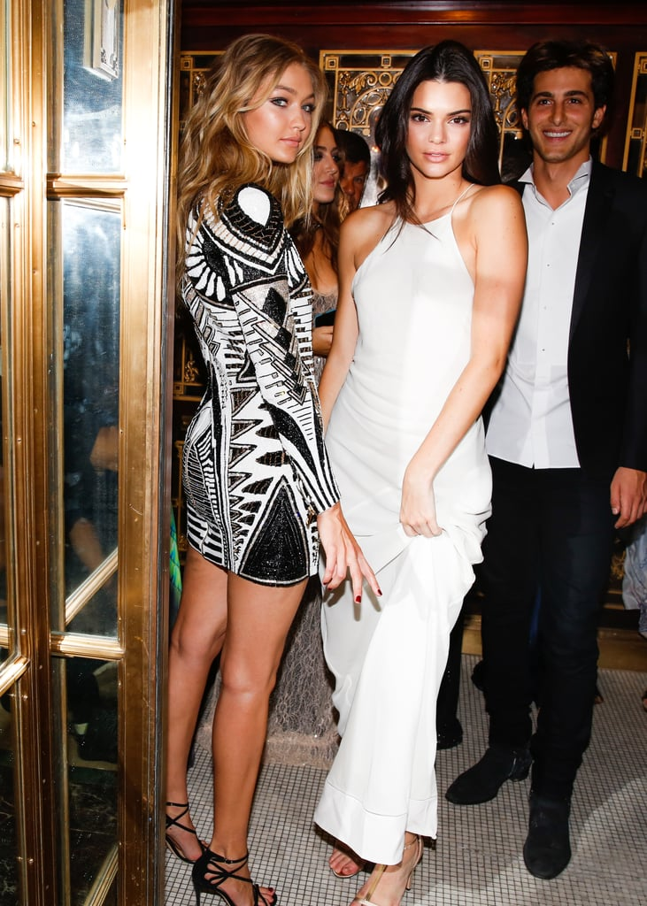 Gigi arrived on the scene and spent the night with Kendall Jenner, who chose a slinky white Calvin Klein dress rather than opting for a shorter hemline.