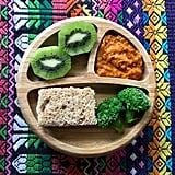 """""""Lunch: hummus and cheese sandwich on whole grain bread, broccoli in butter, orange lentils, and kiwi."""""""
