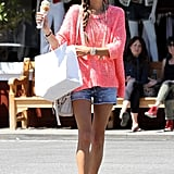 Alessandra Ambrosio wore a pink top and denim Big Star USA shorts.