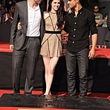 Robert Pattinson, Kristen Stewart, and Taylor Lautner shared an affectionate moment standing in wet cement.