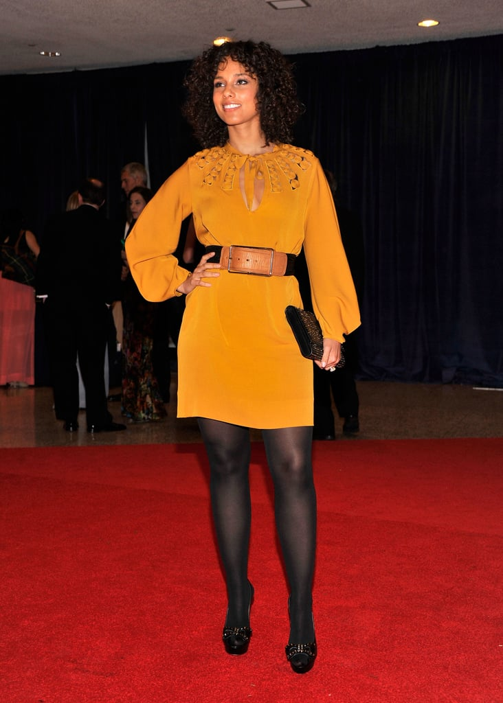 Alicia Keys lit up the carpet in bright yellow.