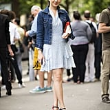 A diaphanous dress gets a dose of classic Americana with her staple denim jacket.