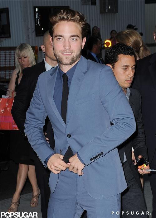 Robert Pattinson, dressed in Gucci, hit the red carpet in NYC tonight for the premiere of Cosmopolis. It's the first time Robert has been spotted in public since the Kristen Stewart cheating scandal. He posed for photos before moving inside for the screening. Hundreds of fans came out to show their support for Rob, some even lining up overnight to get a glimpse of the star. Cosmopolis director David Cronenberg and Rob's leading lady from the movie, Sarah Gadon, were also both there amid the fan frenzy.  The film made its worldwide debut at the Cannes Film Festival in May, but now Rob's sharing his David Cronenberg-directed project with a North American audience. Kristen Stewart was on hand for the French premiere, though that was before the photos of Kristen cheating with Rupert Sanders emerged. Since then, Rob reportedly moved out of their shared Los Feliz, CA, home and retreated to Reese Witherspoon's Ojai estate to avoid the spotlight. Today marks the first of many upcoming promotional appearances for Rob. In addition to the premiere, he also taped an episode of The Daily Show With Jon Stewart and is scheduled to ring the bell at the NY Stock Exhange tomorrow, followed by a GMA stop on Wednesday and an MTV appearance on Thursday.